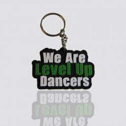llavero promocional de plastisol sobre diseno we are level up dancers